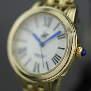 Beverly Hills Polo Club gold plated wristwatch with Roman numerals and blue hands