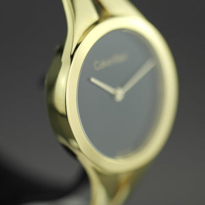 Calvin Klein Addict Black Dial Gold plated Bangle Ladies Watch