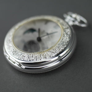Silver plated pocket watch with Roman numbers and day and night indicator