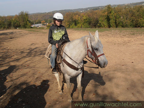 Our youngest son on the trail ride with us - riding Jake