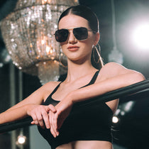 brunette model wearing king ryan 898 gold and grey sunglasses