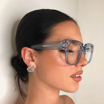 brunette wearing the 004 sky blue and blue light glasses