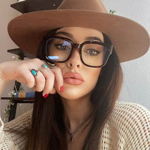 brunette wearing the 004 tortoise and blue light glasses
