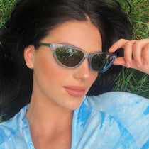 brunette wearing the 013 sky blue and grey mirror sunglasses