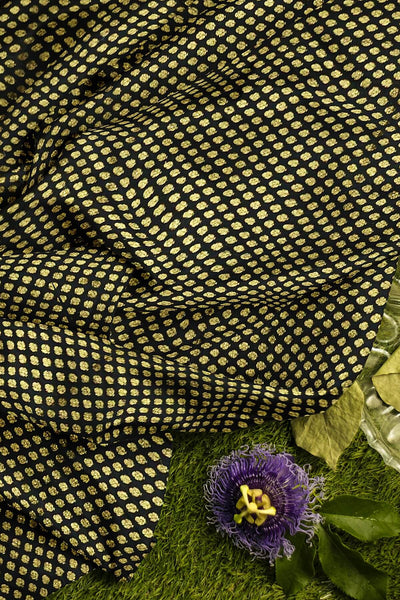 Banarasi  silk fabric in black  . Available in multiples of 1M & 2.5M