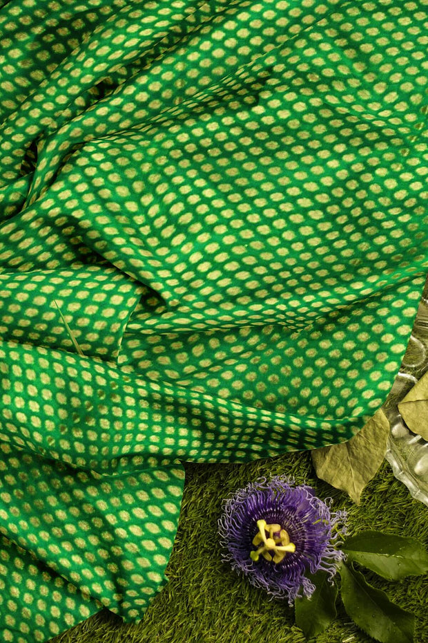 Banarasi  silk fabric in green  . Available in multiples of 1M & 2.5M
