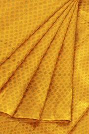 Banarasi  silk fabric in saffron yellow . Available in multiples of 1M & 2.5M