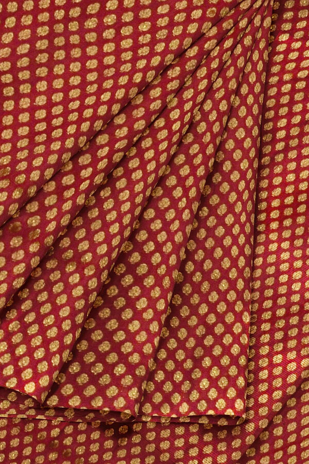 Banarasi  silk fabric in maroon . Available in multiples of 1M & 2.5M