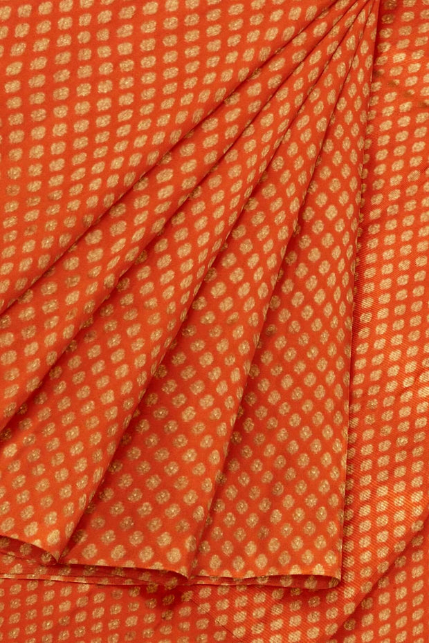 Banarasi  silk fabric in orange. Available in multiples of 1M & 2.5M