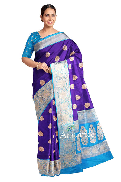 Handloom Banarasi katan pure silk saree in violet with floral motifs  and a 9 inch border. Complemented by  a rich blouse