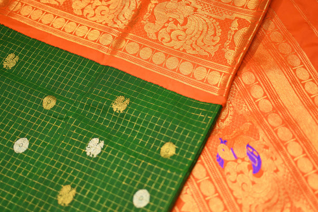 Kanchi pure silk pure zari saree in green in fine checks with peacock & bead motifs in gold and silver