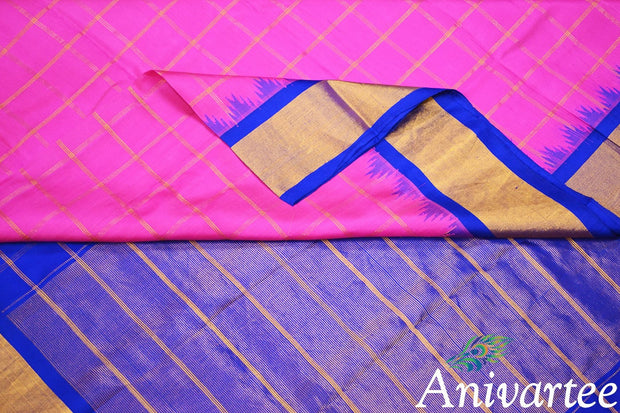 Handwoven Gadwal pure silk saree in checks pattern in pink & blue with temple border.
