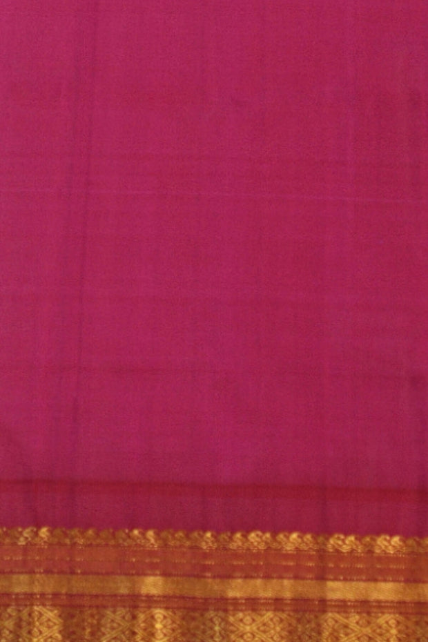 Handwoven gorgeous Gadwal pure silk saree with  small buttas all over the body and a  temple border