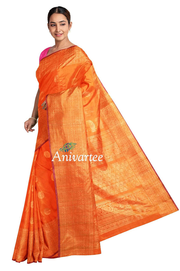 Handloom Gadwal silk saree in orange in dupion (jute) finish with buttas - Anivartee