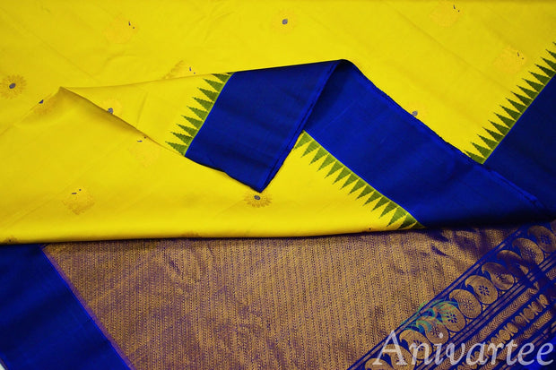 Handloom Gadwal pure silk saree in yellow with elephant & disc motifs and a kuttu temple border