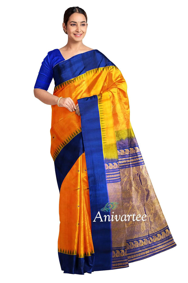 Handloom Gadwal pure silk saree in orange with elephant & disc motifs and a kuttu  temple border.