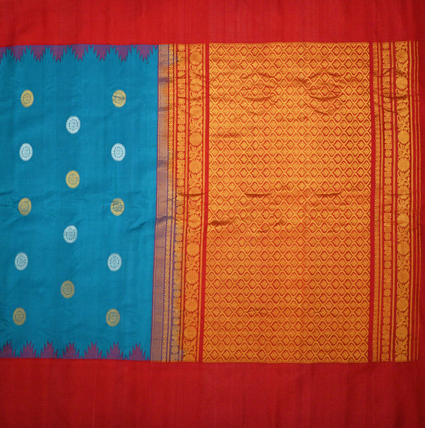 Handloom Gadwal pure silk saree in blue with gold & silver disc motifs and a kuttu temple border