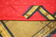 Handloom Gadwal pure silk saree in red  with small  motifs  and a  kuttu  temple border.