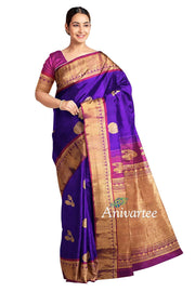 Handwoven Gadwal pure silk saree in blue with musical instruments motifs and a contrast  pallu