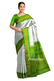 Handwoven Gadwal pure silk saree in white with small motifs and kuttu temple border in green