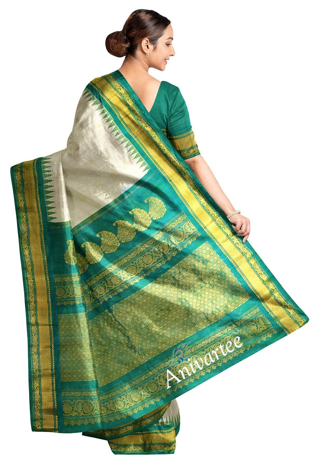 Handwoven Gadwal pure silk saree in off white with small motifs and kuttu temple border in teal  green