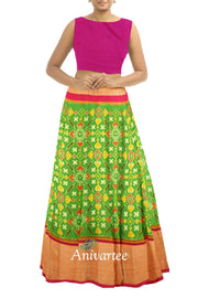 Handwoven Ikat pure silk unstitched lehenga material  in green in pan patola pattern  with  pink  blouse and a rich zari border