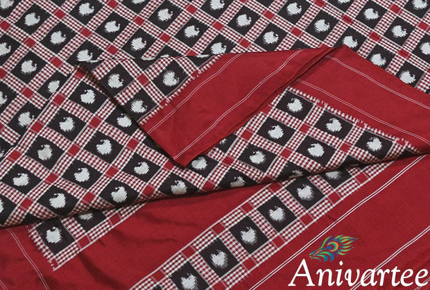 Gorgeous double Ikat telia pure silk saree in black with intricately crafted mango motifs