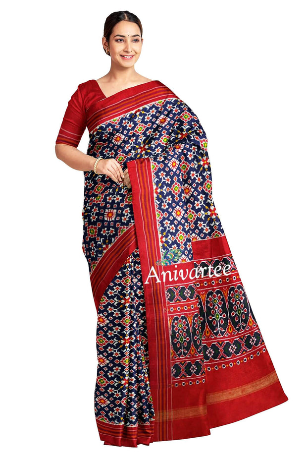 Stunningly beautiful & expertly crafted, handwoven double ikat pure silk saree in navy blue in  navaratan pattern