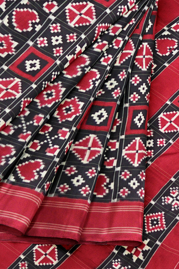 Double ikkat telia pure silk saree in black base in 9 motifs pattern