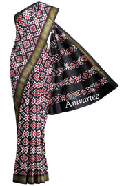 Double ikkat telia pure silk saree in black base with geometric pattern.