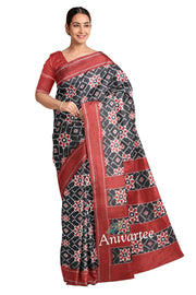 Gorgeous double ikkat telia pure silk saree in black base with floral pattern