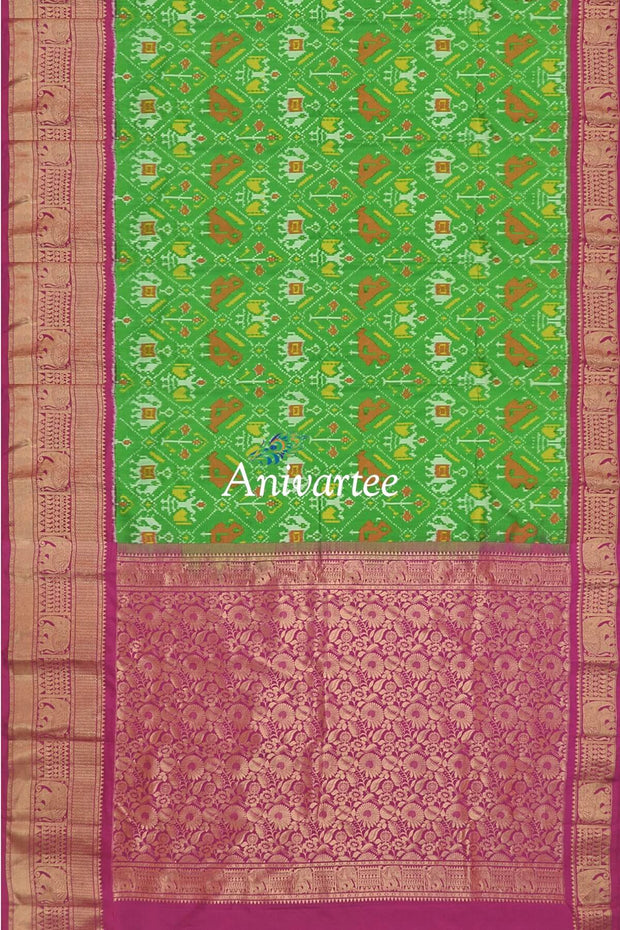 Ikkat pure silk saree in green in narikunj  and a rich kanchi border.
