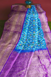 Ikkat pure silk saree in aqua blue in pan patola pattern and a rich kanchi border