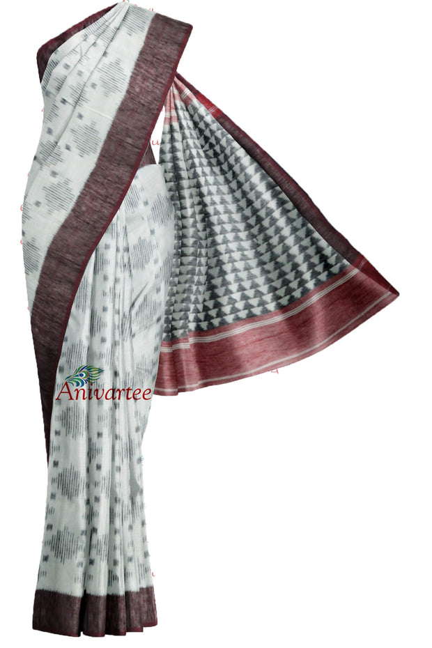 Handwoven Ikkat linen silk saree in off white.