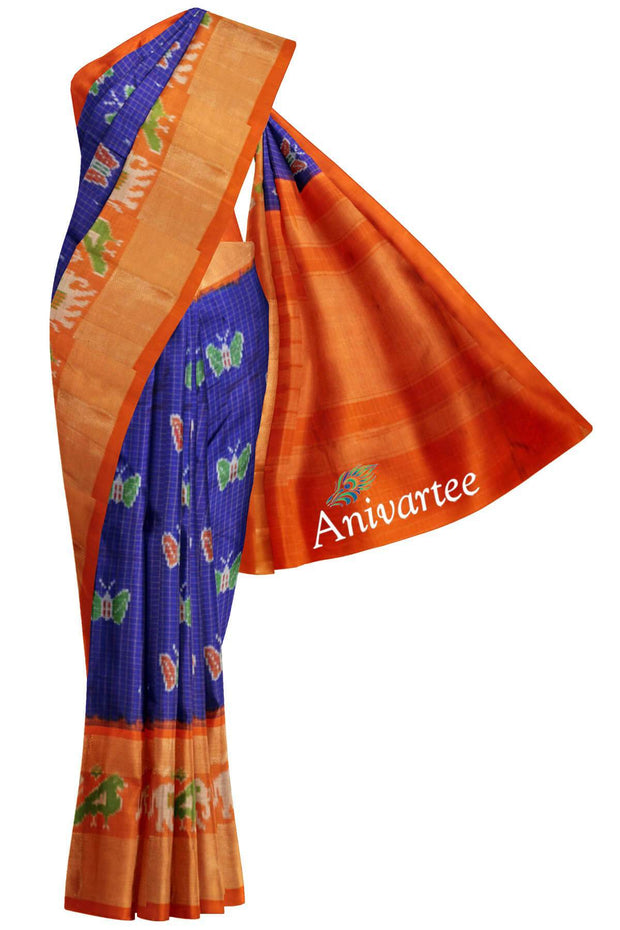 Handloom Ikat pure silk saree in blue & orange with zari checks and a double zari border. Body has butterfly motifs.