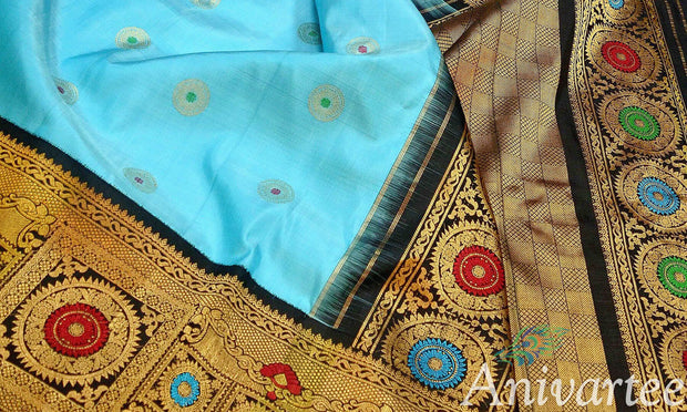 Kanchipuram pure silk pure  zari saree with buttas all over and  a big border with chakra motifs
