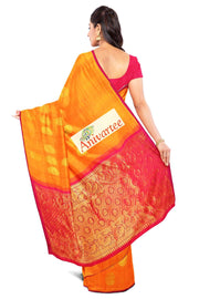 Handloom Kanchi borderless silk saree in  mustard yellow with floral motifs . - Anivartee