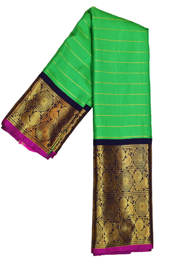 Kanchi pure silk pure zari saree in green with zari stripes