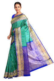 Handwoven Kanchi pure silk  saree in teal green  with round motifs.