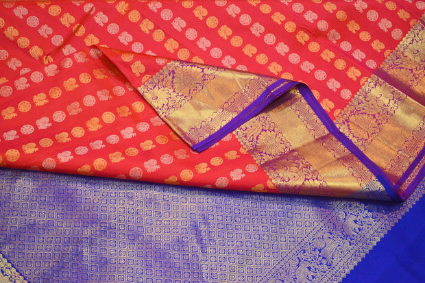 Handwoven Kanchi pure silk saree in orangish pink with disc & peacock motifs