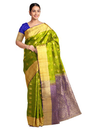 Handloom Kanchi pure silk saree in green with peacock & disc motifs. - Anivartee