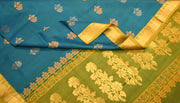 Kanchi soft silk saree in blue with floral motifs in gold and silver - Anivartee