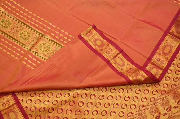 Handloom Kanchi pure silk saree in peach with rich pallu . - Anivartee