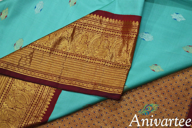 Handwoven Kanchi pure silk pure zari saree in pool blue with parrot motifs in meenakari