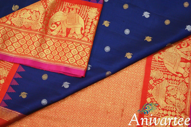 Handwoven Kanchi pure silk pure zari saree in navy blue with peacock & disc motifs in gold and silver