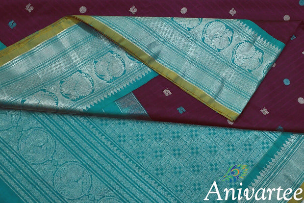 Handwoven Kanchi pure silk pure zari saree in berry with peacock & disc motifs in blue and silver