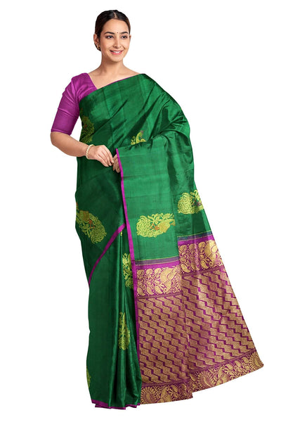 Handwoven  Kanchi borderless pure silk saree in  dark green with peacock  motifs