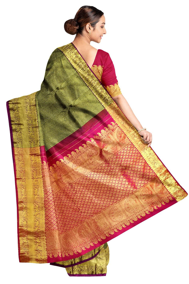 Handwoven Kanchi pure silk brocades saree in dark green with pallu in magenta