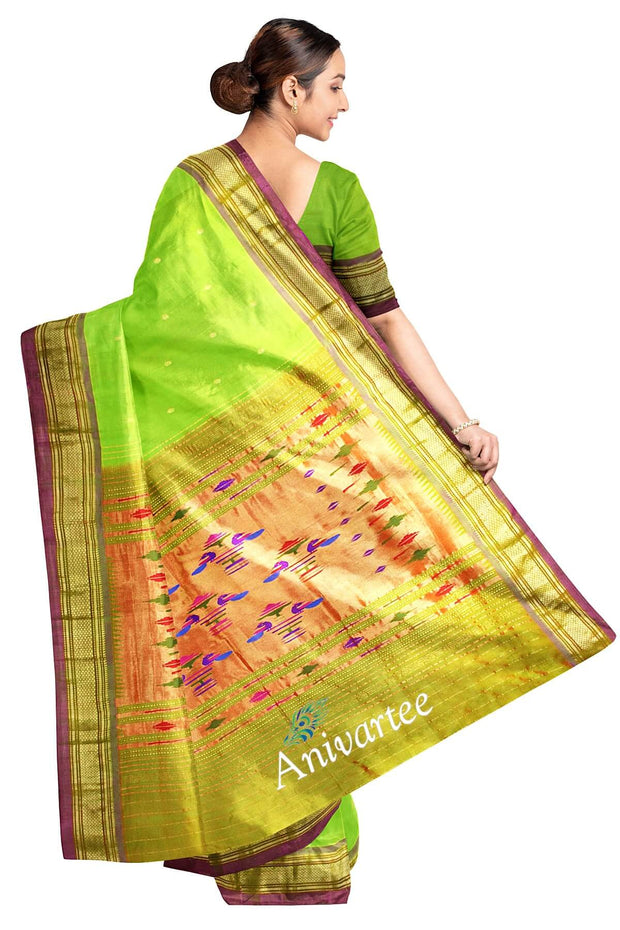 Handwoven Paithani pure silk saree in green with small mango motifs on the body and contrast pallu.