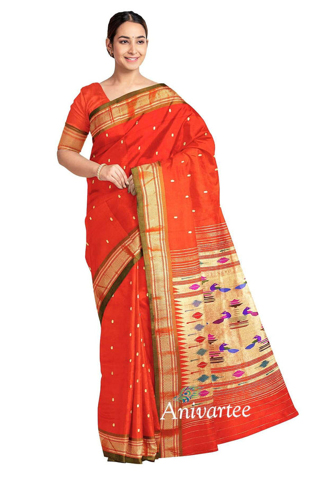 Handwoven Paithani pure silk saree in reddish orange with small mango motifs on the body and a contrast pallu.